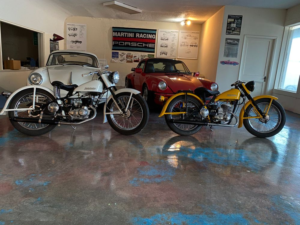 White bike is 1951 Harley Davidson. Yellow bike is 1953 Harley Davidson.