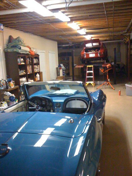 The '67 Vette looks on, as my poor '68 811 gets a middle-of-a-road-trip oil cooler installed...