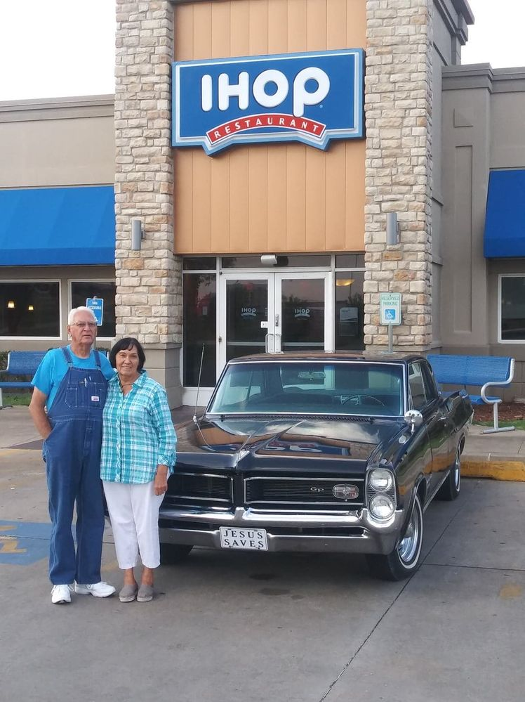 Bill and Sue Bonner with the '64 Grand Prix.