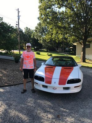 My 30th Anniversary Z-28 Camaro. I purchased it new and have 59,000 miles on it. One of around 400 produced with 6-speed, t-tops and houndstooth seat inserts. Thanks to my Beautiful wife for walking outside on crutches to take this pic. We live on Bull Shoals lake in Arkansas.